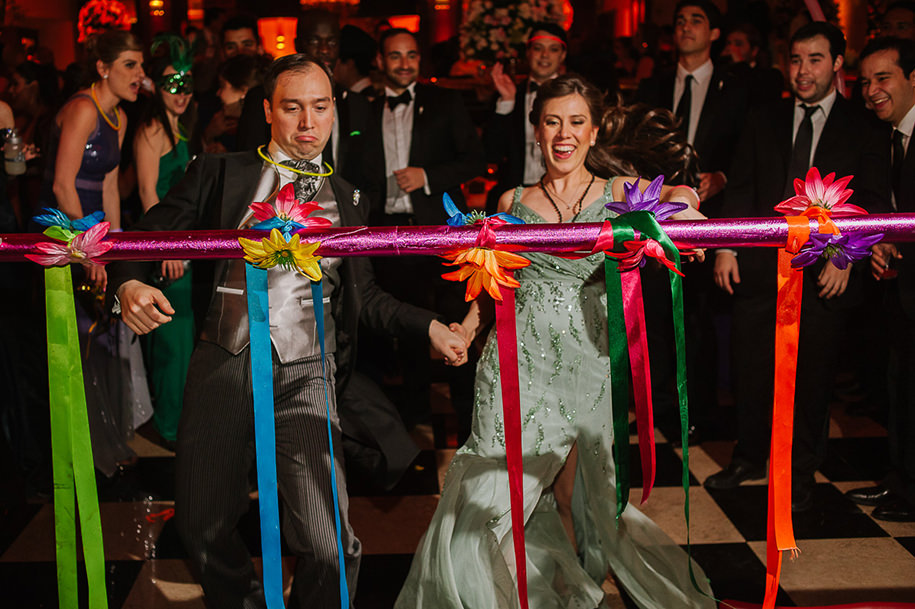 Groom and sister dancing the limbo during reception at Gran Hotel Ancira