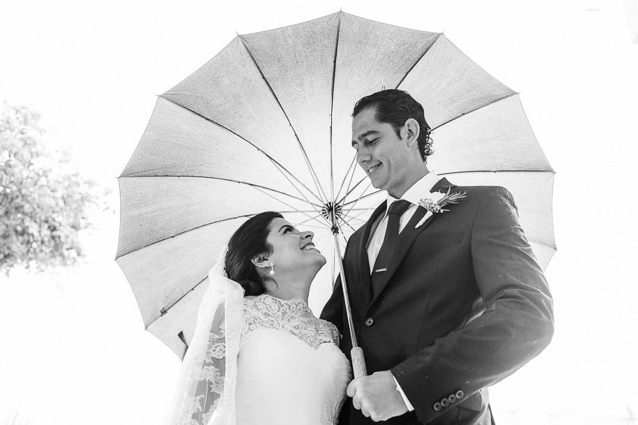 bride and groom portrait under umbrella