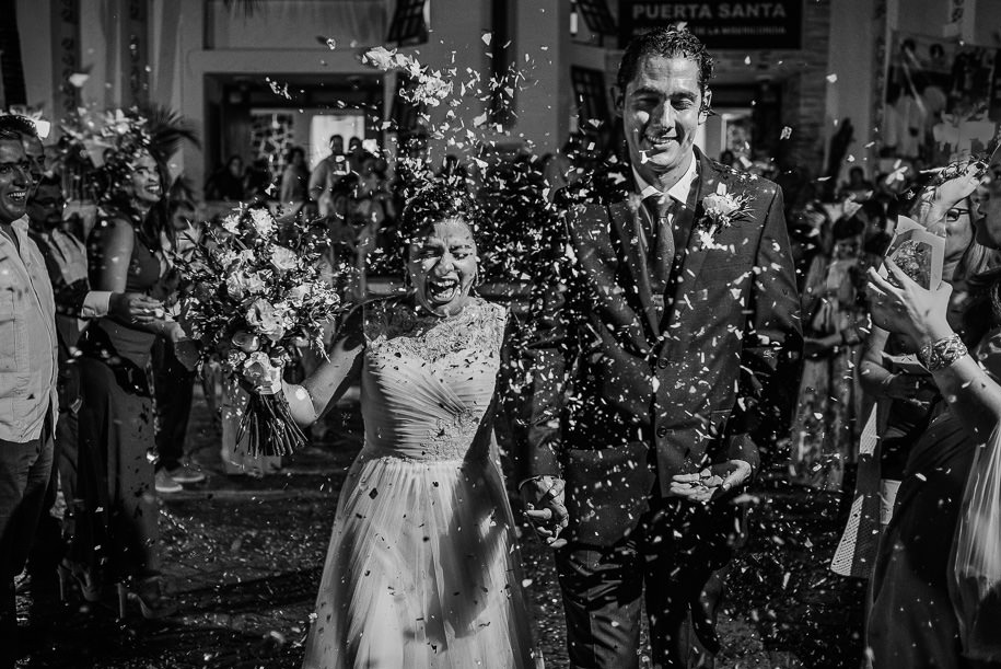 Bride and groom exit confetti tossed