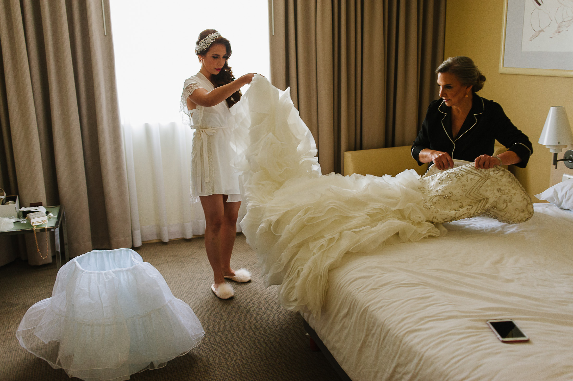 Bride getting ready with her mom in hotel room