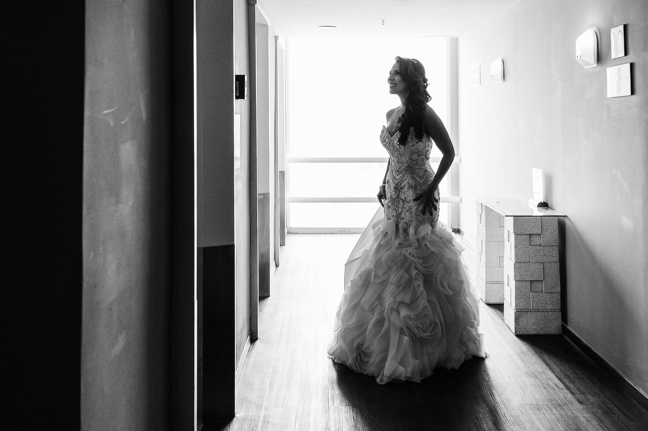 Bride waiting by the elevator for first look