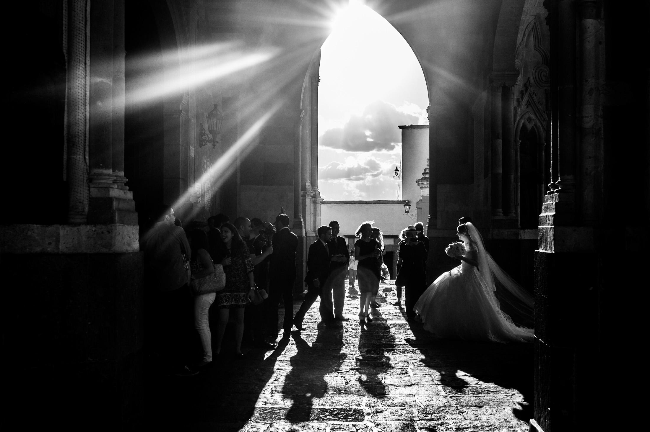 Bride walking in the Parroquia de San Miguel Arcángel with beautiful light