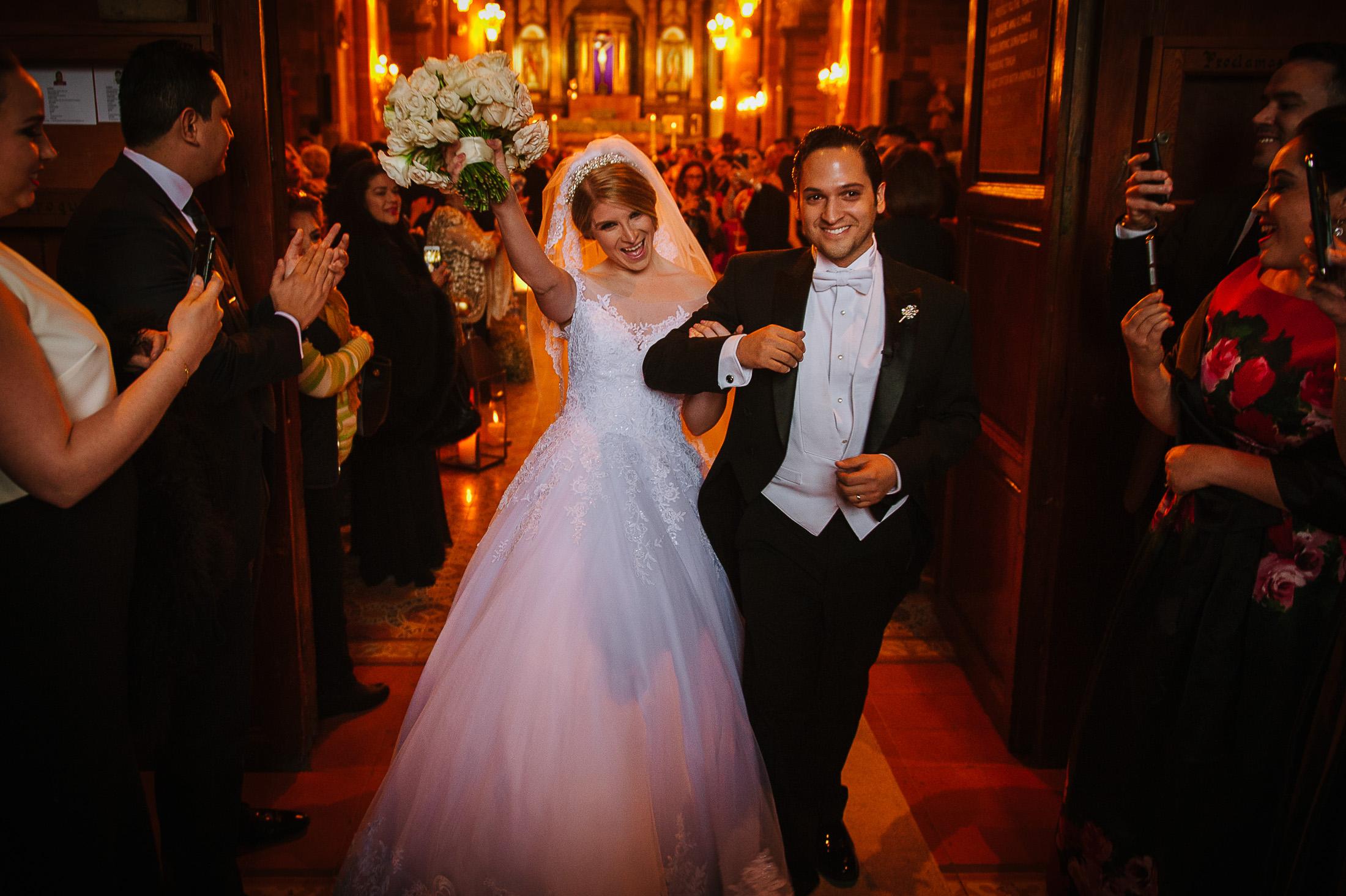Bride and groom walking out church in San Miguel de Allende