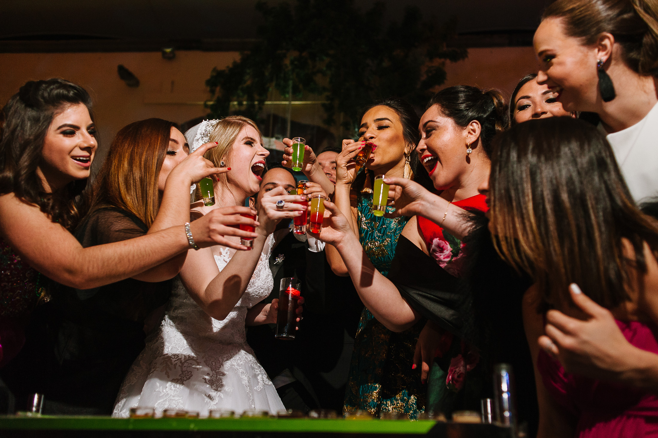 Bride and bridesmaids tequila shots