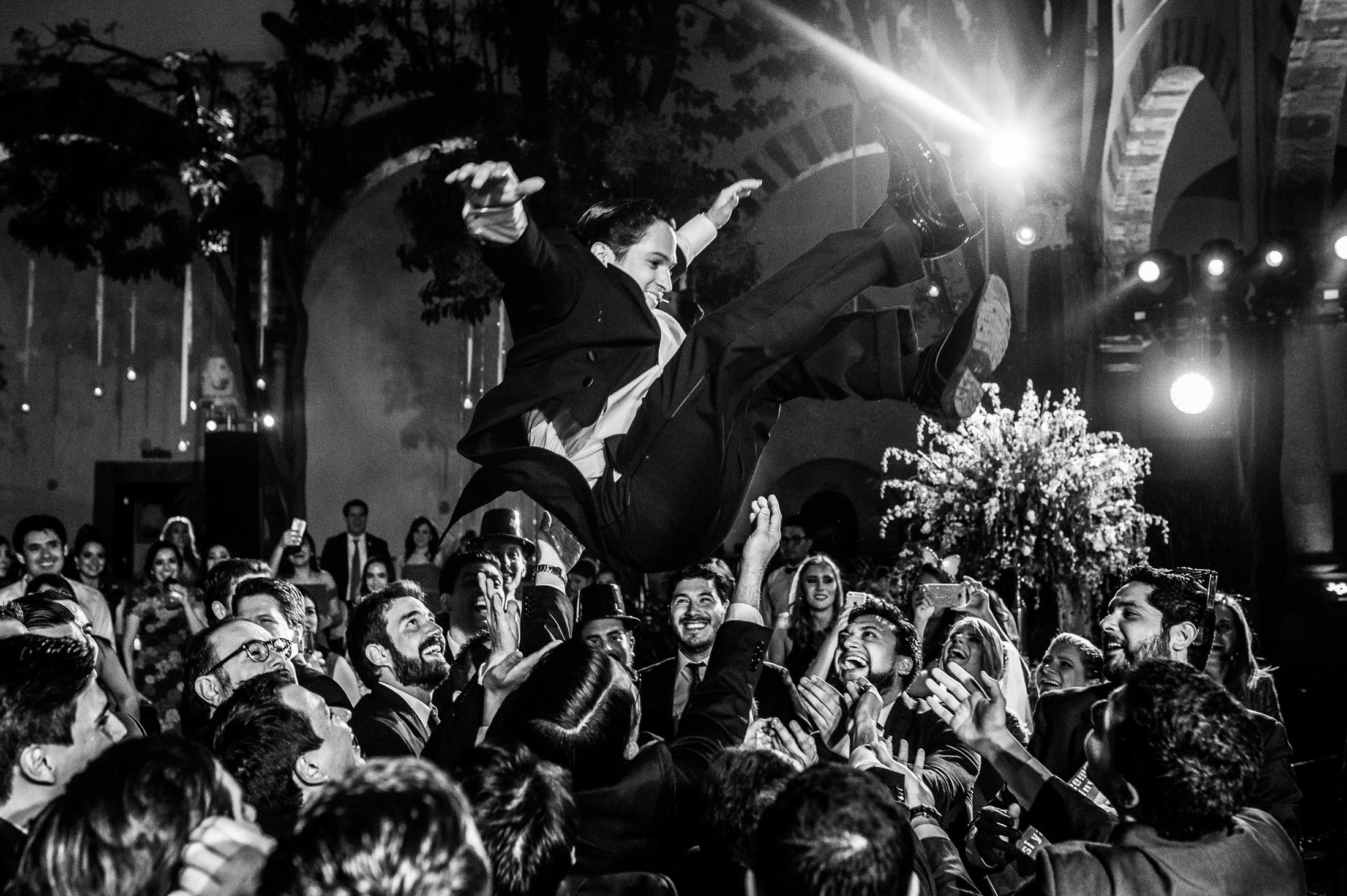 Groom tosed in the air wedding reception San Miguel de Allende