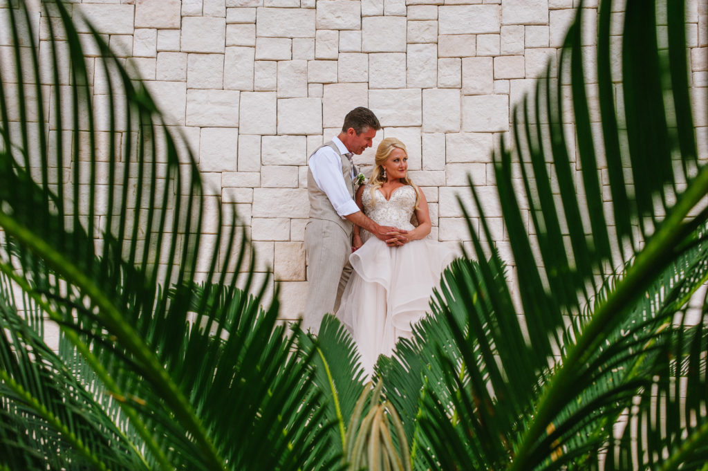 Portrait of Bride and groom at their venue with leafs