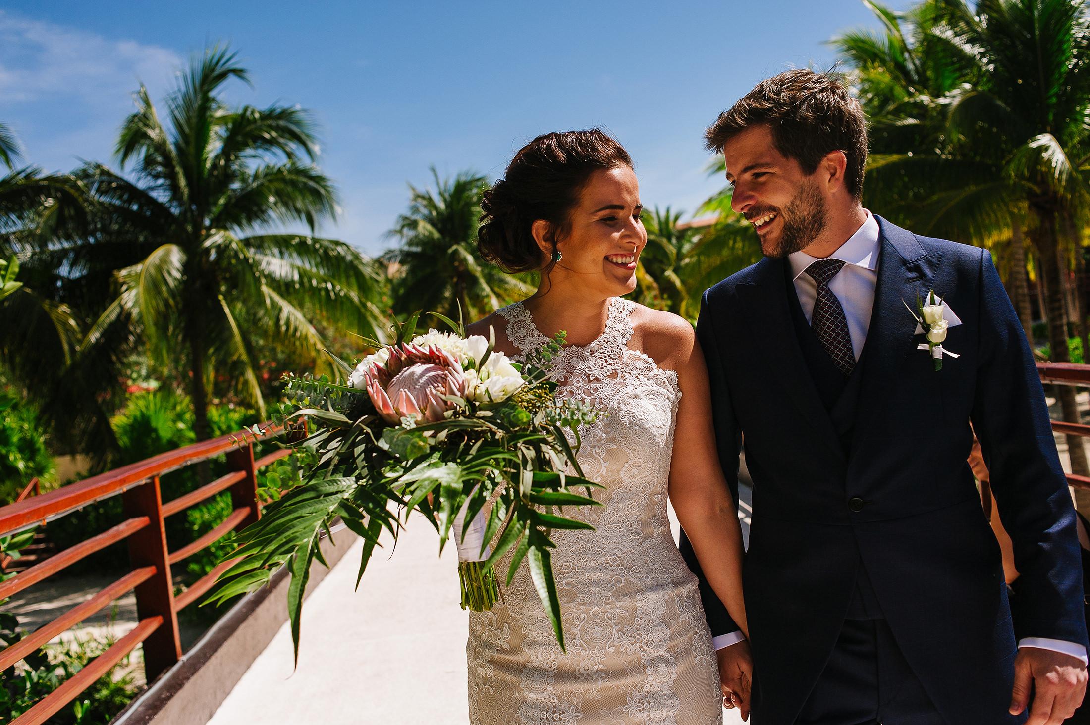 Bride and groom walking on the paths of Hacienda Tres Rios