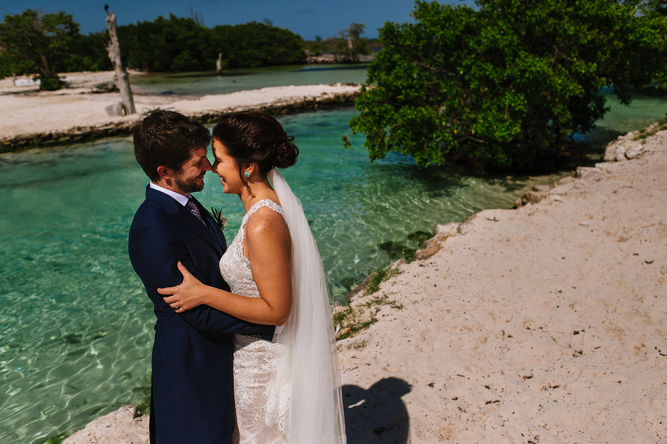 Portrait of bride and groom near the beach of tres rios