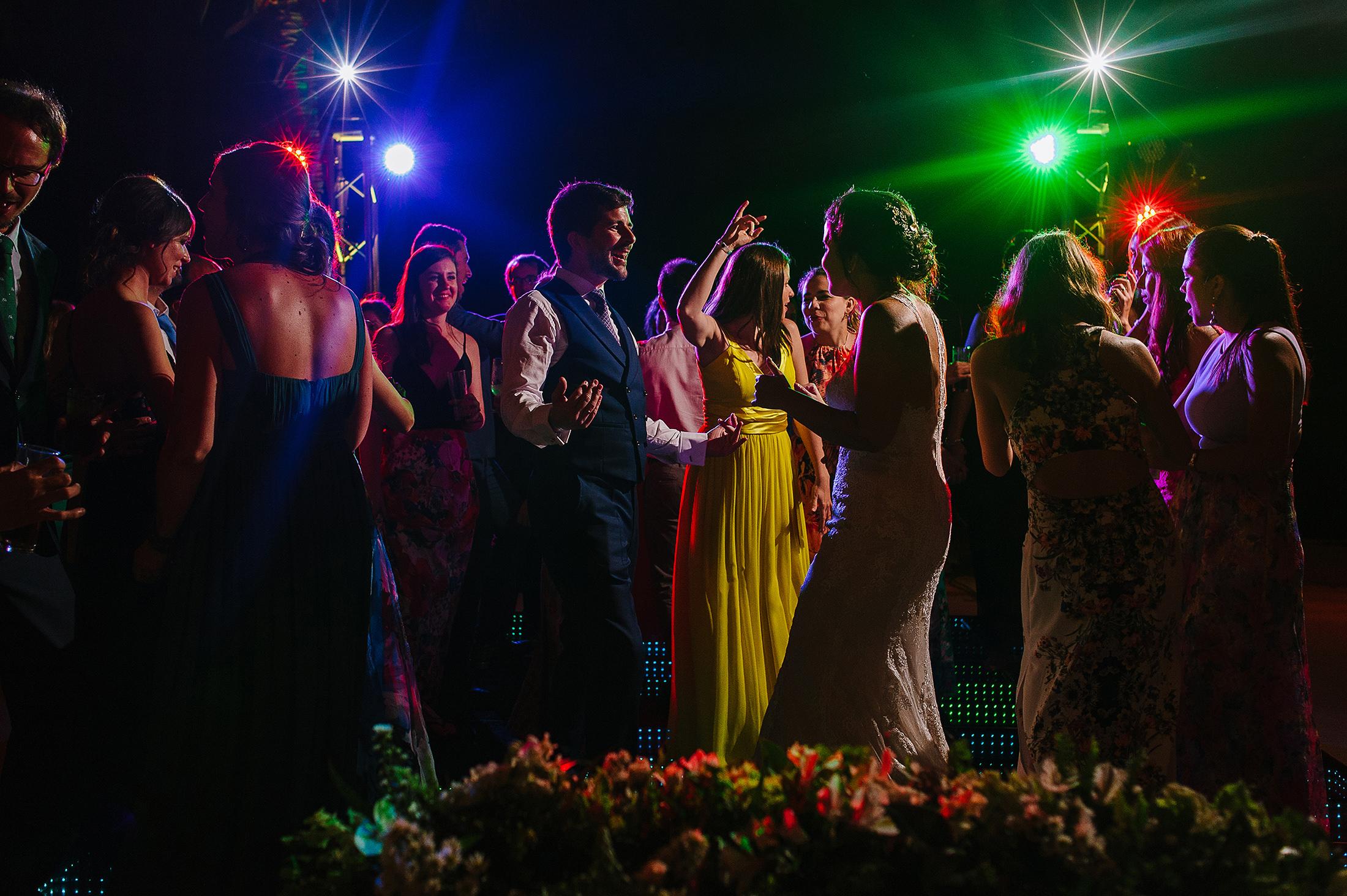 Packed dance floor of wedding guests in Riviera Maya