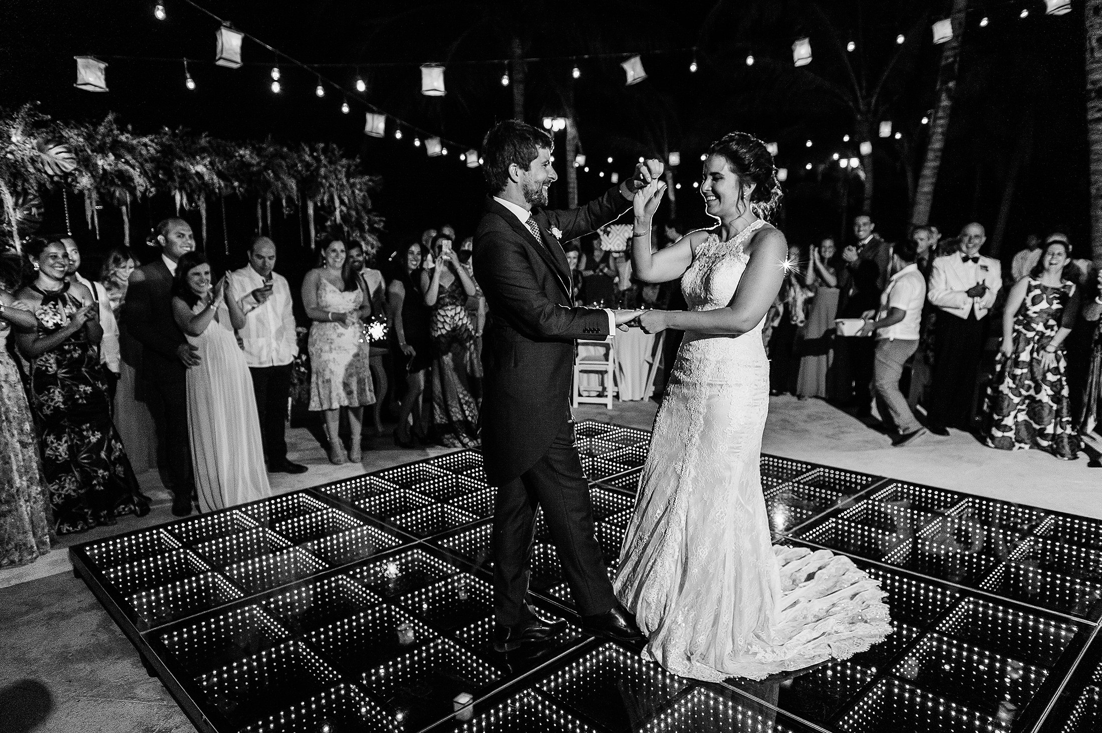 First dance in black and white bride and groom having fun