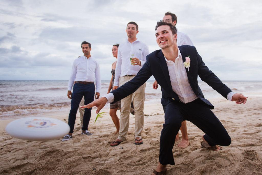 Blue Venado beach groom playing ultimate frisbee