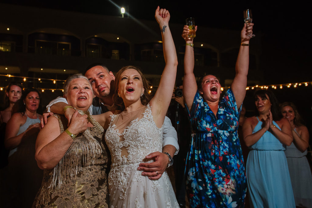 Bride, groom and guests reacting to fireworks in wedding in Riviera Maya