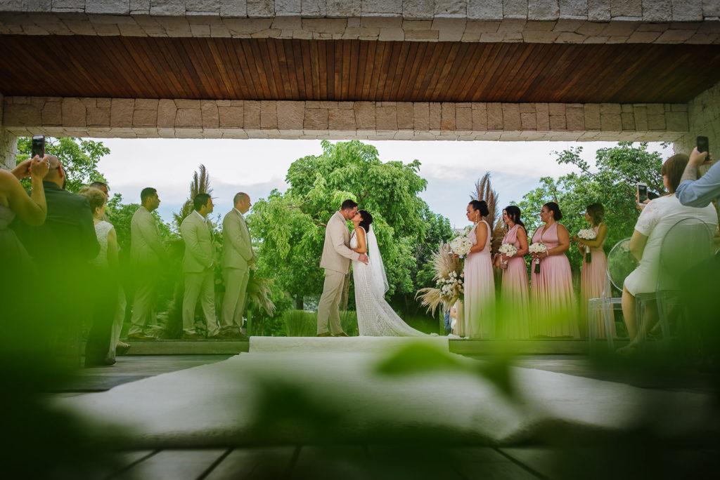 Bride and groom kiss at the end of the ceremony at Nizuc wedding