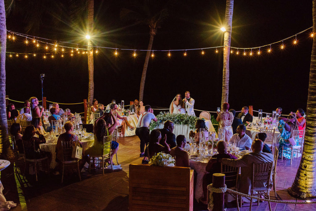 Beautiful terrace wedding reception lit with string lights at Secrets Capri