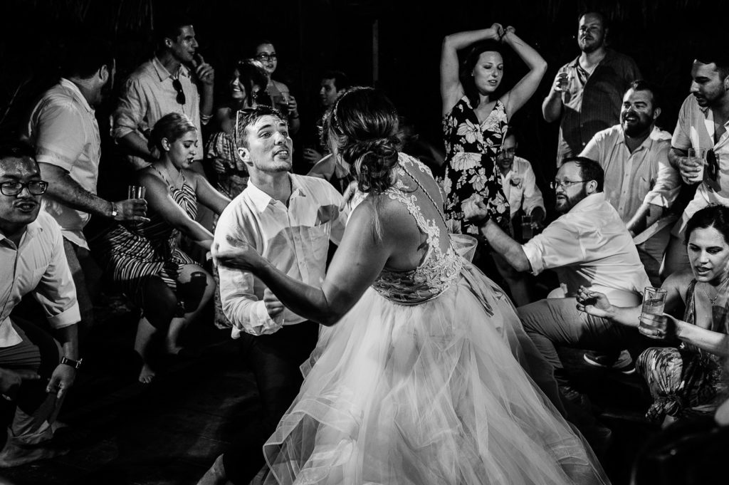 Bride and groom dancing on a crowded dancefloor during reception at Blue Venado