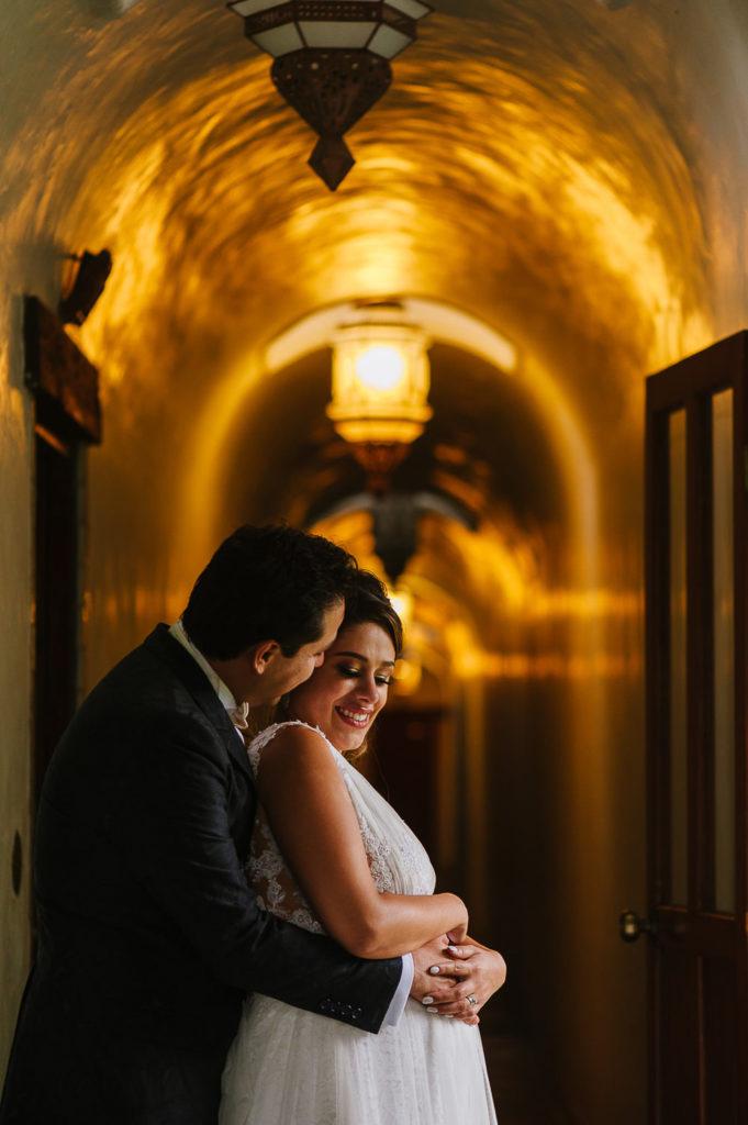 Pregnant bride portrait with groom holding her in Hotel Las Mañanitas in Cuernavaca