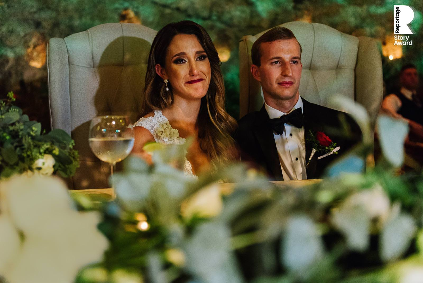 Bride and groom at the head table emotional reaction to speeches during reception at La Isla Xcaret