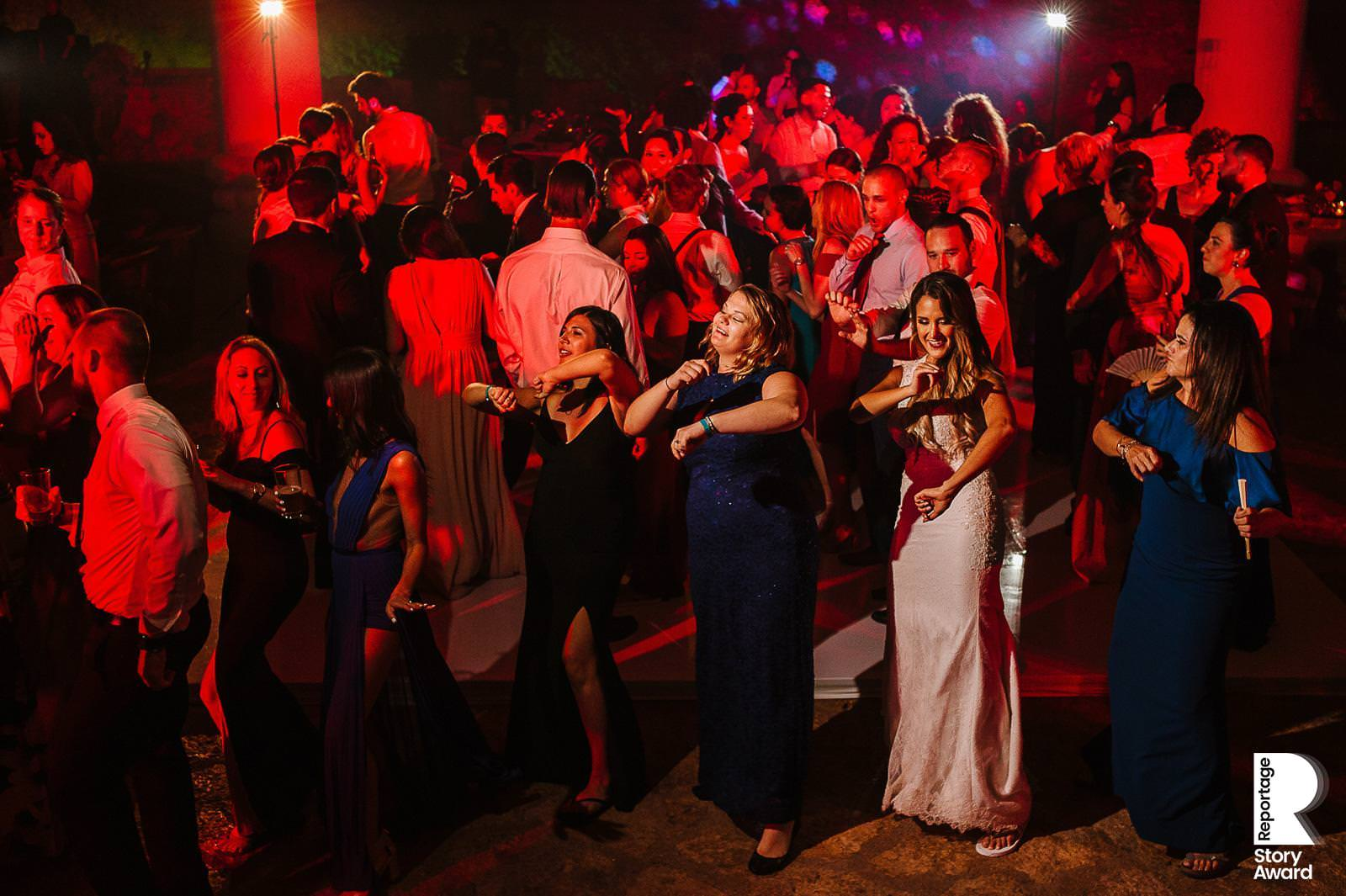 Bride and friends on the dance floor dancing a choreography of electric boogie