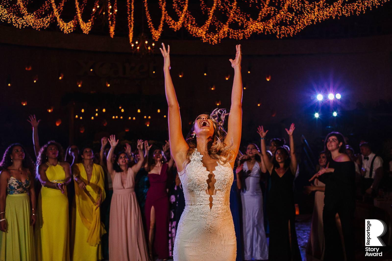 Boquet toss at Xcaret party reception at la Isla Mexico destination Wedding