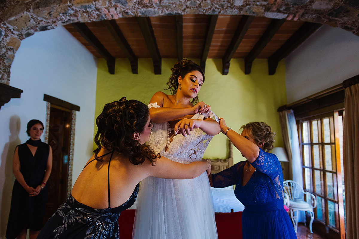 Bride gets dress in beautiful Hacienda room venue