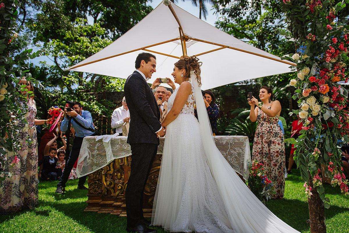 Bride and groom say their vows during garden ceremony