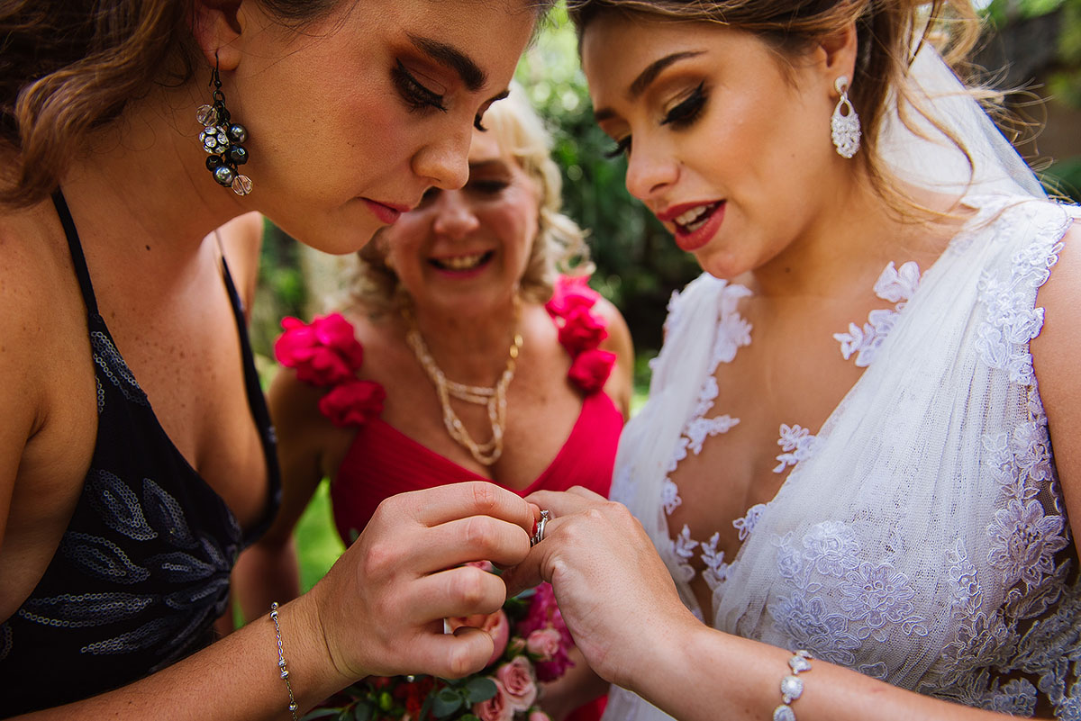Bride shows her ring to her cousin and aunt