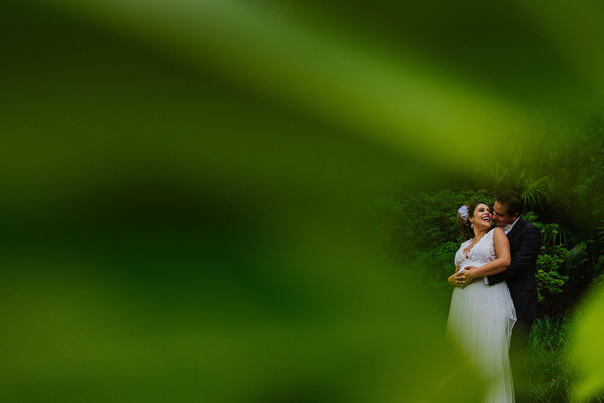 Portrait of bride and groom with green foreground and background in Hacienda wedding venue Mexico