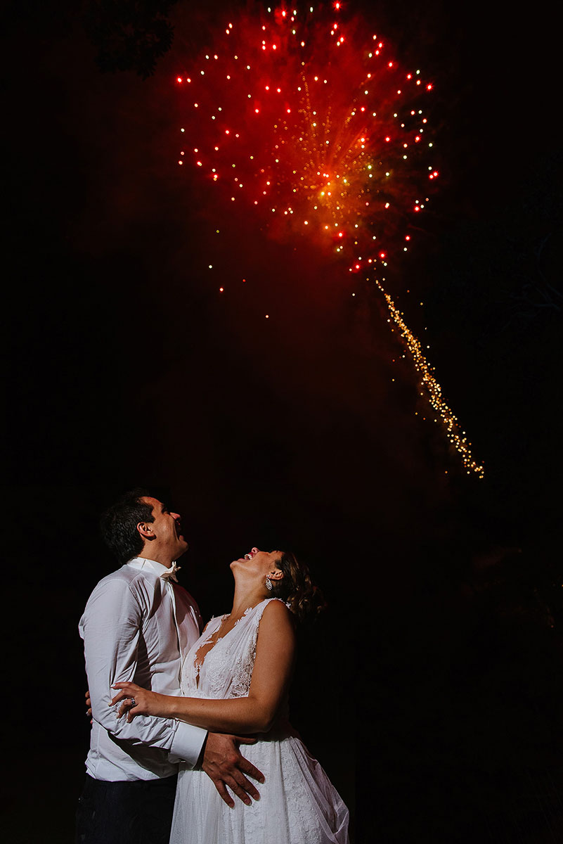 Bride and groom watching fireworks at the end of the night in Las Mañanitas venue un Cuernavaca