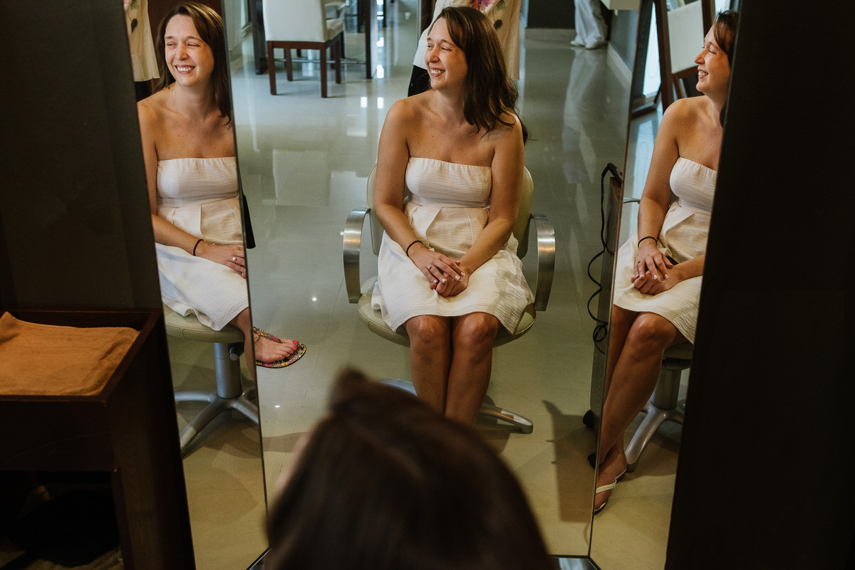 Bride reflection on mirror getting ready at the spa in riviera cancun