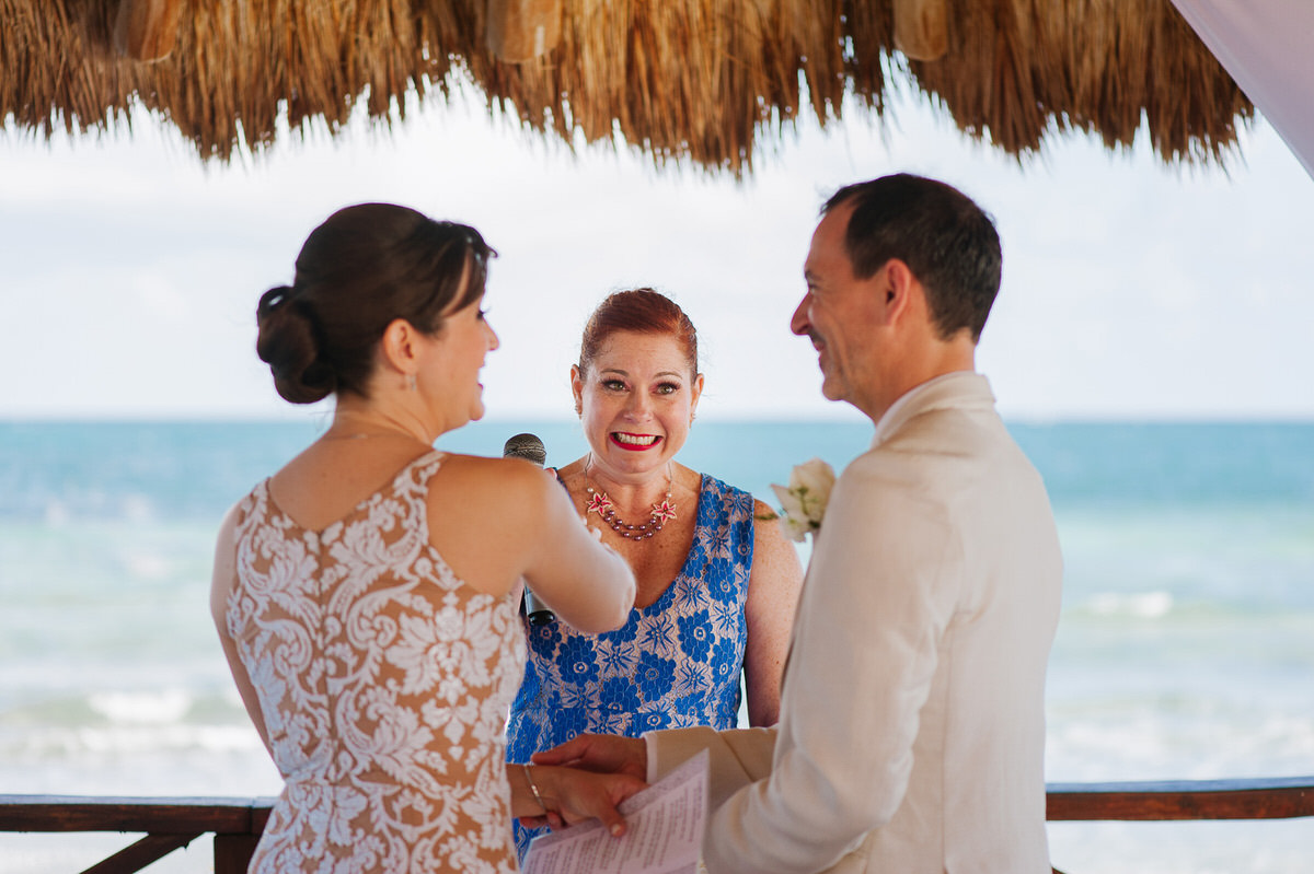 Excited officiant of beach ceremony in Cancun