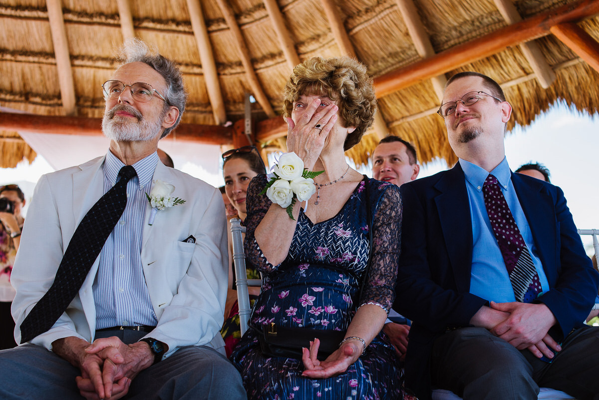 Emotional parents and brother of the bride during beach Ceremony in Cancun