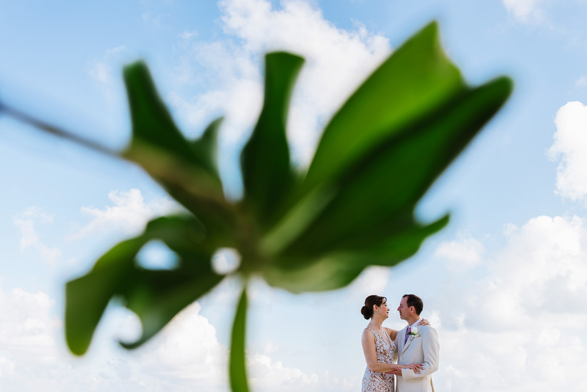 Creative portrait in Riviera Cancun green leaves