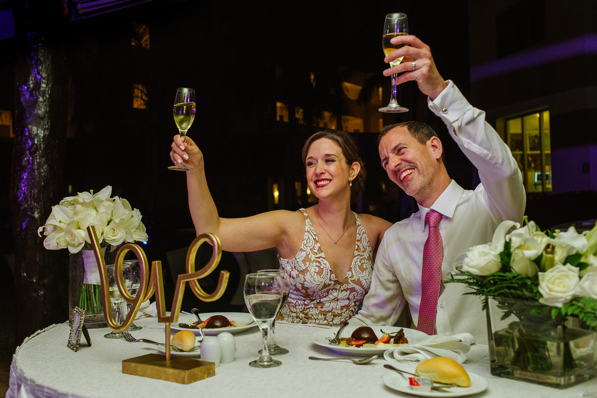 bride and groom toast in Riviera Cancun reception