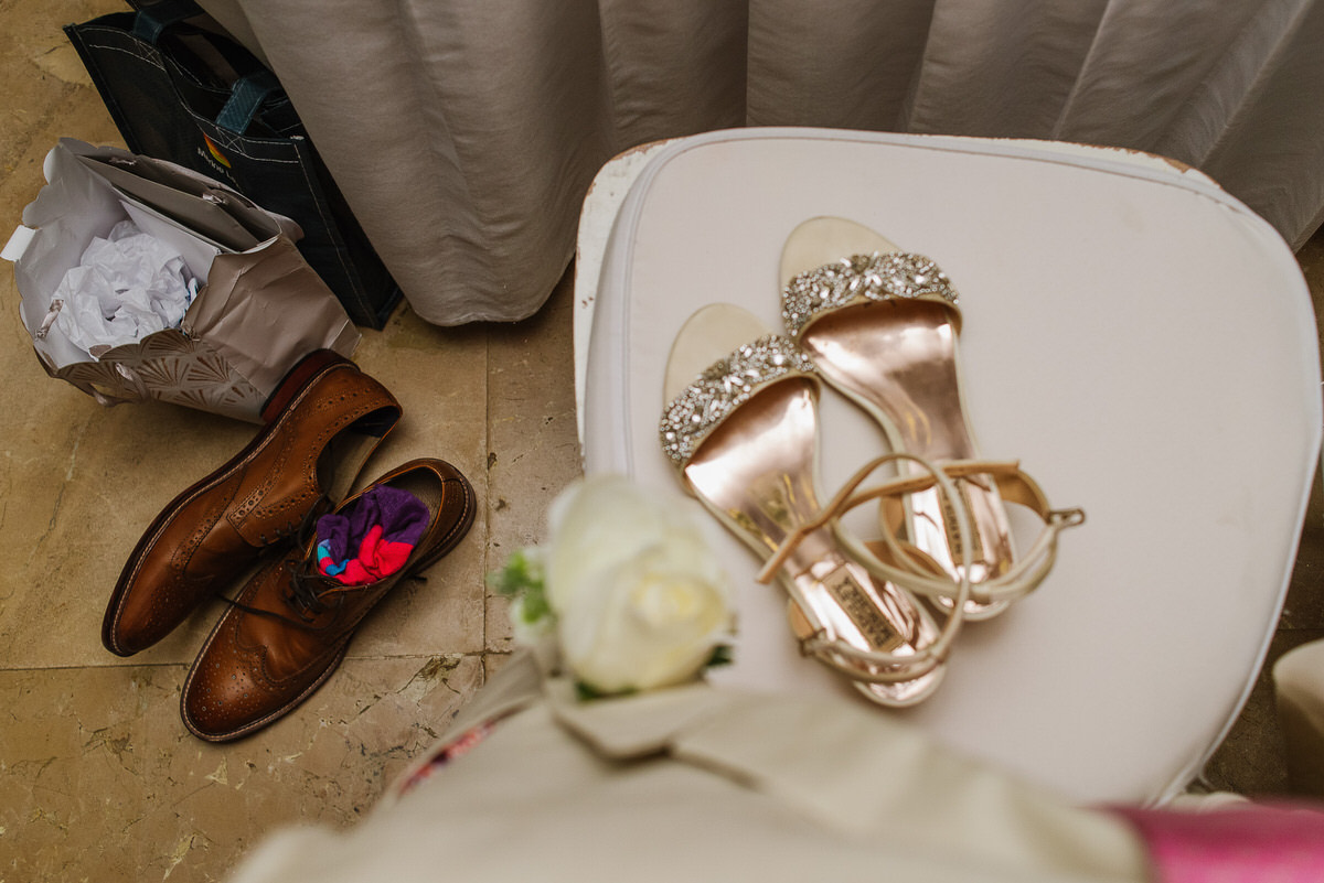 Bride and groom shoes on chair during wedding reception in Cancun