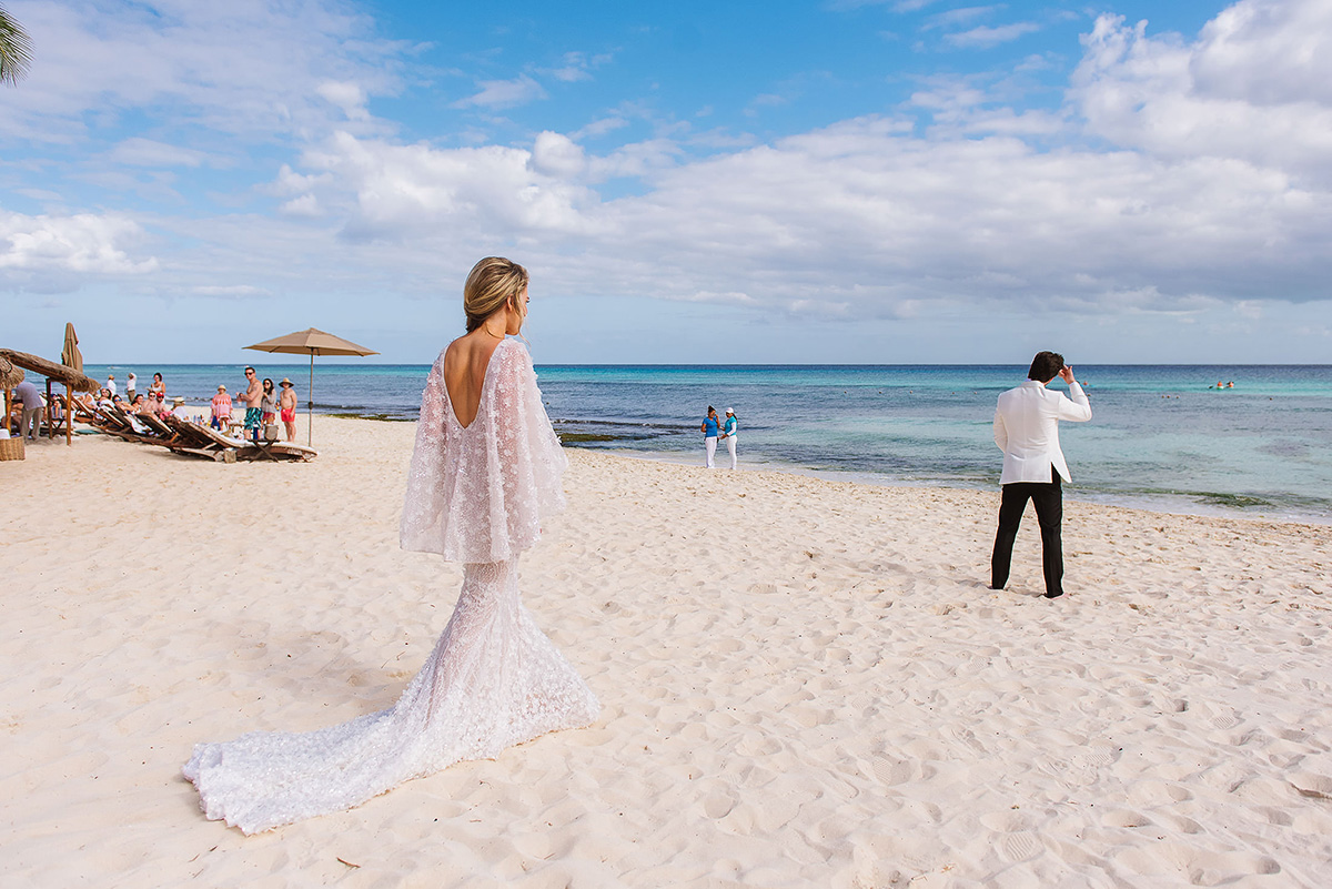 Gorgeous beach first look bride dress