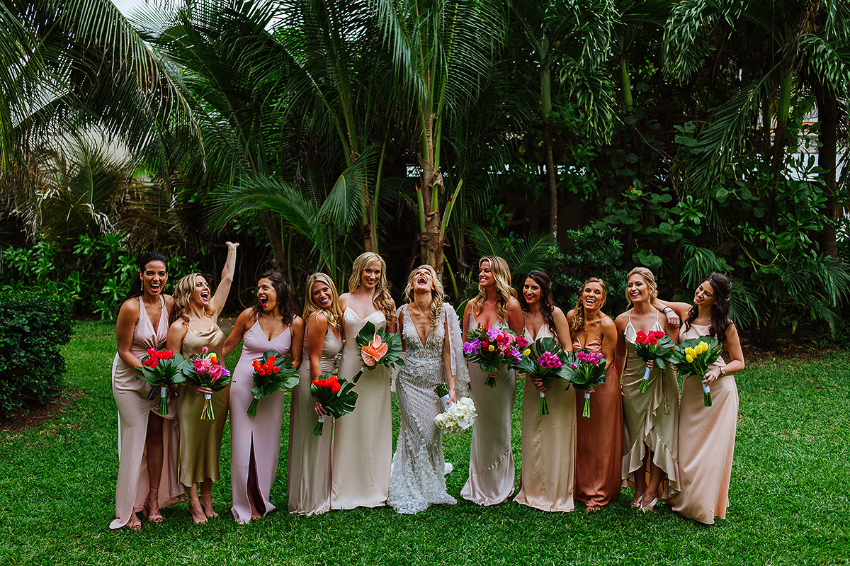 Gorgeous riviera maya portrait of bride and bridesmaids laughing at Viceroy Hotel