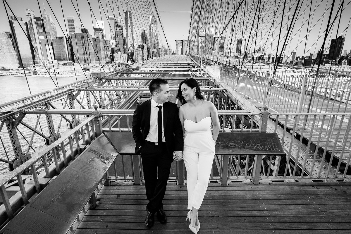 Black and white wide portrait on Brooklyn Bridge