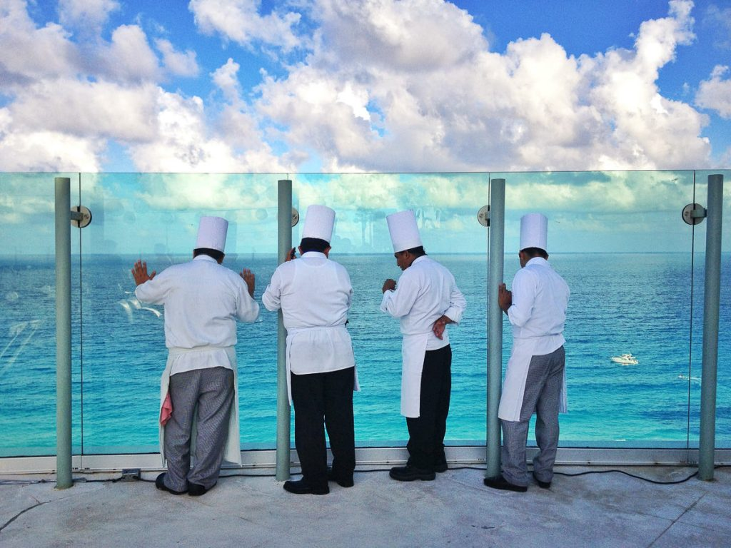 Chefs enjoying the view at a venue terrace in Cancun.